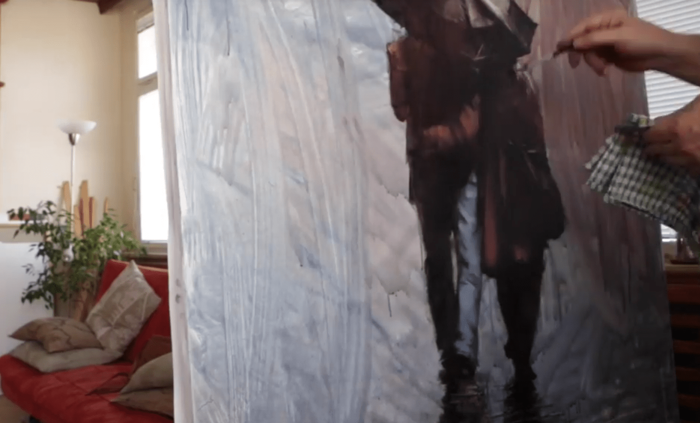 Artist Igor Shulman at work painting Rainy