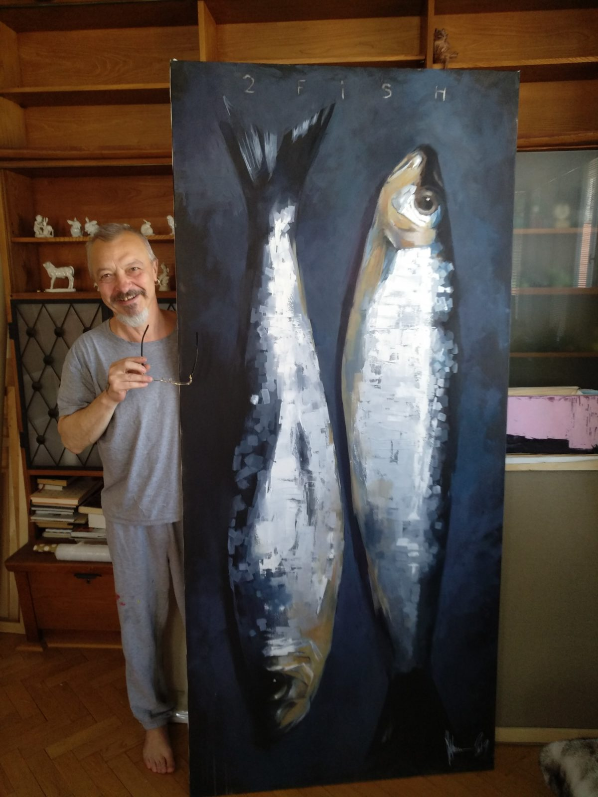 2 fish painting and Igor in his studio